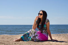 Attractive young woman on the beach. Attractive young woman in sunglasses on the beach Royalty Free Stock Image