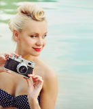 Attractive young woman on the beach with vintage details, travel Stock Images