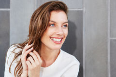Attractive young woman with beautiful smile. Close up portrait of attractive young woman with beautiful smile Stock Images