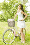 Attractive young woman with bicycle Stock Photo