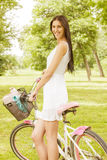 Attractive young woman with bicycle Royalty Free Stock Images