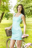 Attractive young woman with bicycle Royalty Free Stock Image