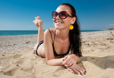 Attractive young woman in bikini on on seashore Royalty Free Stock Photography