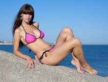 Attractive young woman in bikini on seashore Royalty Free Stock Photo