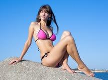 Attractive young woman in bikini on seashore Royalty Free Stock Photos