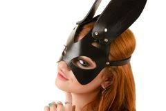 Attractive young woman in black bunny mask Stock Photos