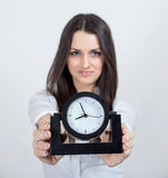Attractive young woman and black clock Royalty Free Stock Image
