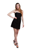 Attractive young woman in a black dress smiling and looking at c. Amera Royalty Free Stock Photo