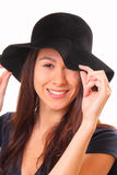 Attractive young woman in a black hat Royalty Free Stock Photo