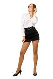 Attractive young woman in a black skirt Royalty Free Stock Images