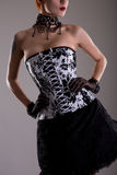 Attractive young woman in black and white corset Stock Photography