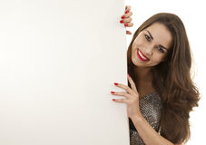 Attractive young woman with blank billboard Stock Photography