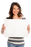 Attractive young woman with blank sign. Young beautiful girl holds a empty white sign for you to fill in your message Royalty Free Stock Image