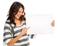 Attractive young woman with blank sign. Young beautiful girl holds a empty white sign for you to fill in your message Stock Image