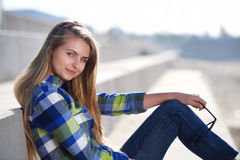 Attractive young woman with blond hair relaxing outside Stock Image