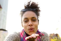 Attractive young woman blowing a kiss Stock Image