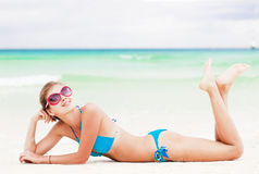 Attractive young woman in blue bikini on tropical boracay beach Stock Photos