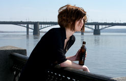 Attractive young woman with bottle Royalty Free Stock Photography