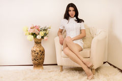 Attractive young woman  in a boudoir Royalty Free Stock Images