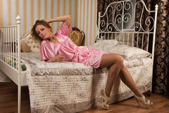 Attractive young woman  in a boudoir Stock Photo