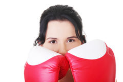 Attractive young woman with boxing gloves. Closeup. Royalty Free Stock Images