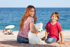 Attractive young woman and boy at the seaside. Royalty Free Stock Images
