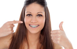 Attractive young woman with brackets saying Ok Royalty Free Stock Photos
