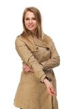 Attractive young woman in brown coat Stock Image