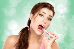 Attractive Young Woman Brushing Teeth Royalty Free Stock Photos