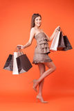 Attractive young woman is buying new clothing Royalty Free Stock Photo