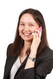 Attractive young woman calling by cellular phone Royalty Free Stock Photography