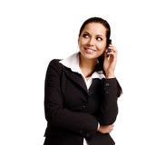 Attractive young woman calling by cellular phone. Isolated over white Stock Images