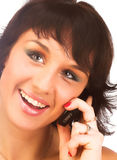 Attractive young woman calling by cellular phone. Stock Image