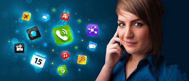 Young woman calling by phone with various icons. Attractive young woman calling by phone with various icons Royalty Free Stock Photography