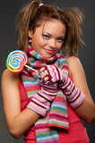 Attractive young woman with candy Royalty Free Stock Images