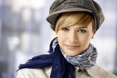Attractive young woman in cap Stock Images