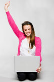 Attractive young woman celebrating with laptop Stock Photo