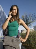 Attractive Young Woman on cell. Attractive Young Woman on mobile phone royalty free stock photography
