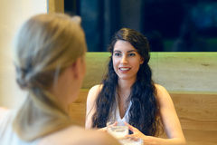 Attractive young woman chatting to her friend royalty free stock photos