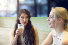 Attractive young woman chatting to her friend Royalty Free Stock Photo
