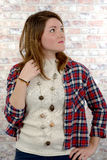 Attractive young woman in a checkered shirt Stock Images