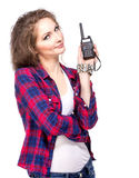 Attractive young woman in a checkered shirt with walkie talkie, Stock Images