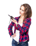 Attractive young woman in a checkered shirt with walkie talkie, Royalty Free Stock Photos