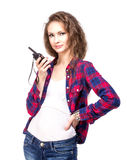 Attractive young woman in a checkered shirt with walkie talkie, Royalty Free Stock Images
