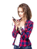 Attractive young woman in a checkered shirt with walkie talkie, Stock Image