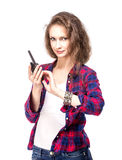 Attractive young woman in a checkered shirt with walkie talkie, Royalty Free Stock Photo