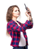 Attractive young woman in a checkered shirt with walkie talkie, Royalty Free Stock Image