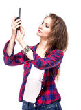 Attractive young woman in a checkered shirt with walkie talkie, Stock Photo
