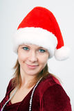 Attractive young woman a Christmas hat Royalty Free Stock Image