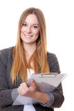 Attractive young woman with clipboard Stock Photos